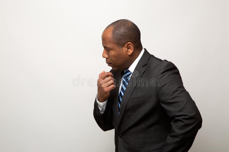 African American Business Man Thinking on Light Gray Background stock photo