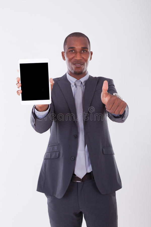 African american business man using a tactile tablet over white royalty free stock photo