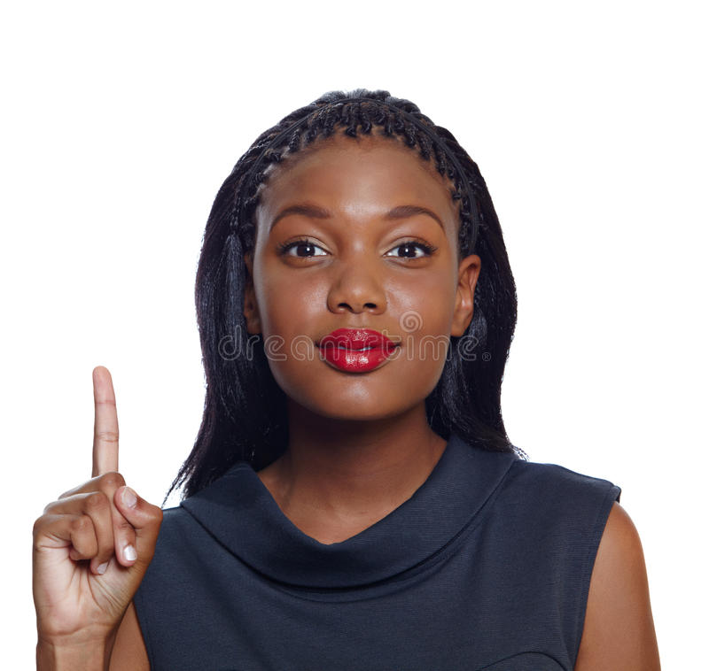 African American business woman. Portrait of a happy African American business woman pointing up with a smile on white background royalty free stock image