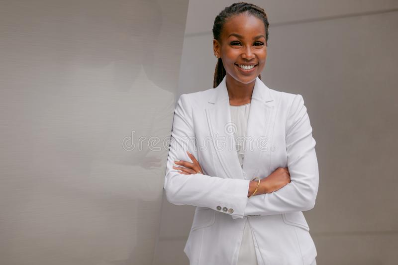 African american business woman smiling confidently, cheerful, accomplished, proud, successful, at financial workplace building. Smiling cheerful headshot royalty free stock photo