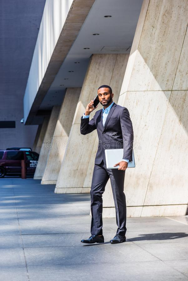 African American businessman with beard talking on cell phone, traveling, working in New York stock image