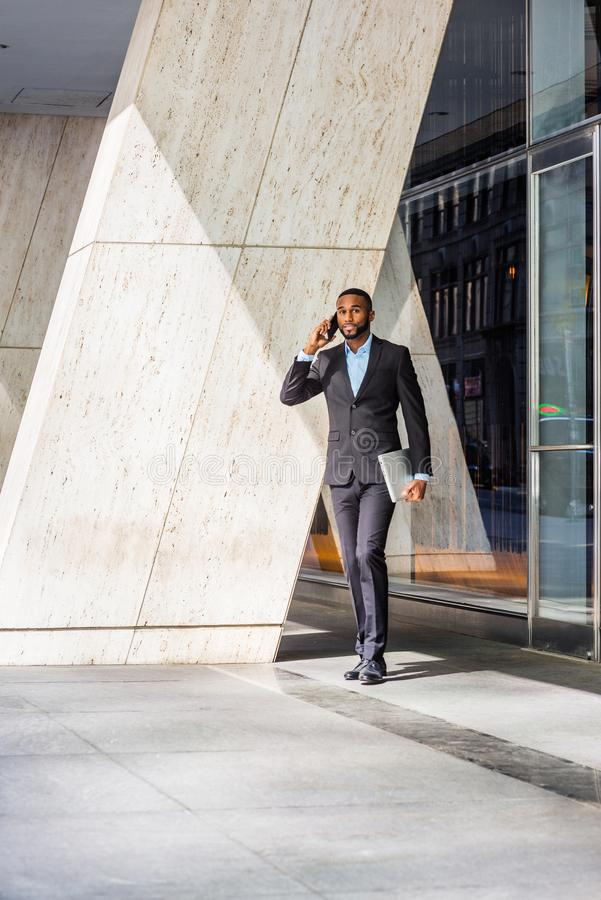 African American businessman with beard talking on cell phone, traveling, working in New York stock photography