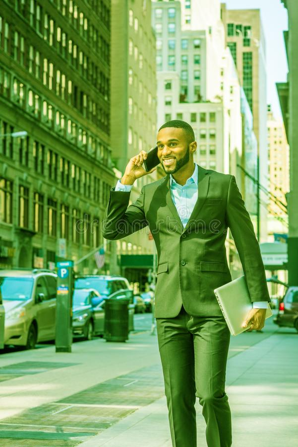 African American businessman with beard talking on cell phone, traveling, working in New York stock photos