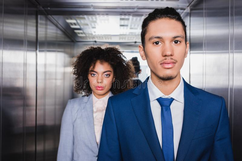 African american businessman and businesswoman standing stock photography