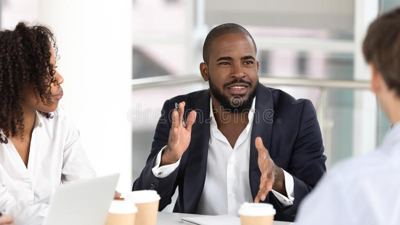 African american businessman coach negotiator speaking at diverse team meeting royalty free stock images