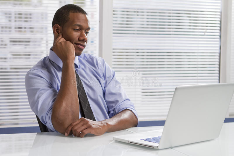 Download African American Businessman At Desk With Computer, Horizontal Stock Image - Image: 34253265