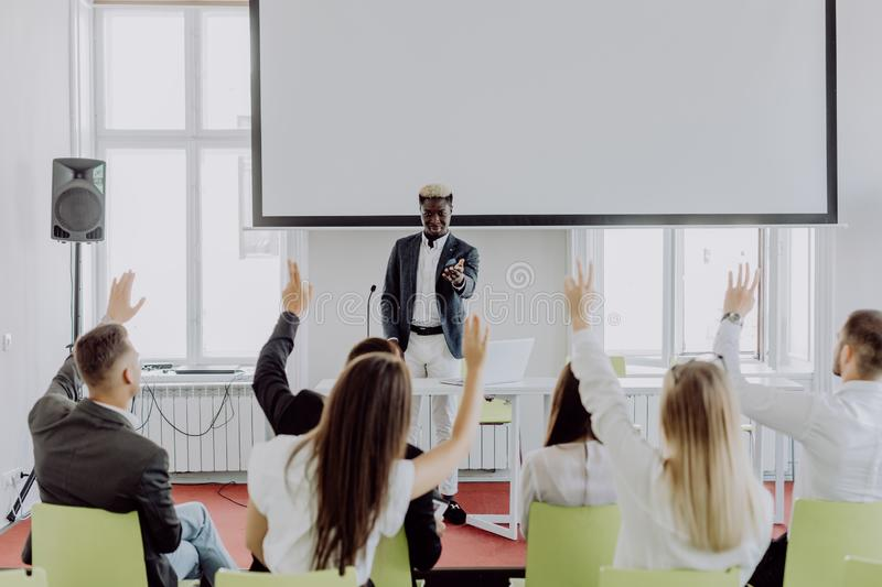 African american businessman giving presentation discussing project with multi-ethnic group at corporate training. Black teaching royalty free stock image