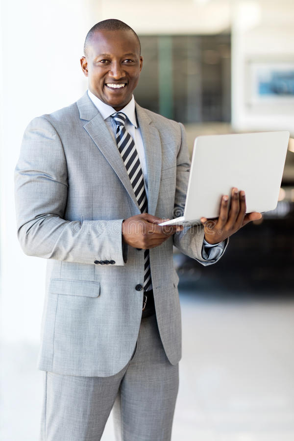 African american businessman laptop. Professional african american businessman with laptop stock photography