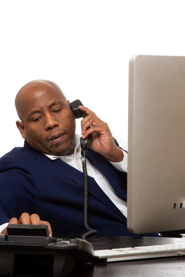 African American Businessman Listens On Phone royalty free stock photos