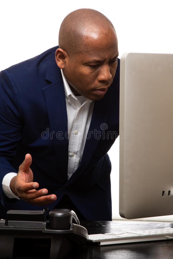 African American Businessman Looks At Computer royalty free stock image