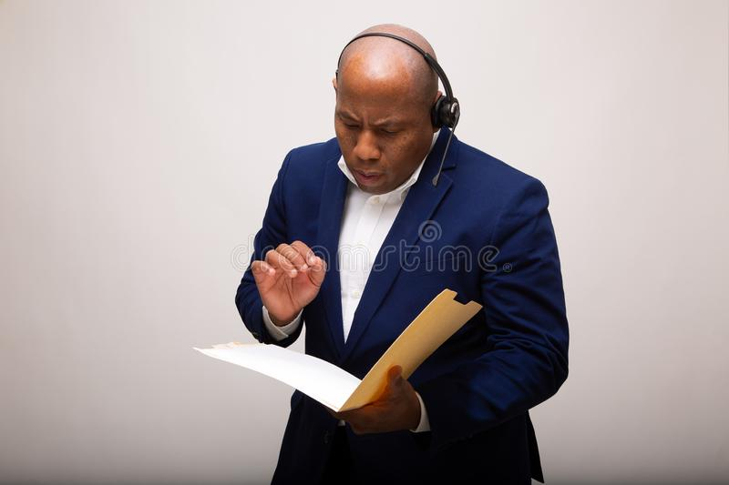 African American Businessman Looks Through File royalty free stock photo