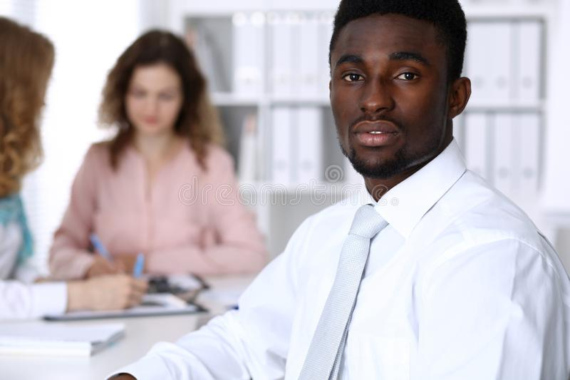 African american businessman at meeting in office, colored in white. Multi ethnic business people group royalty free stock image