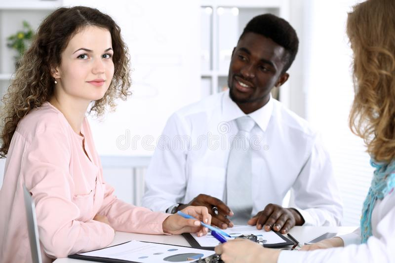 African american businessman at meeting in office, colored in white. Multi ethnic business people group stock photo