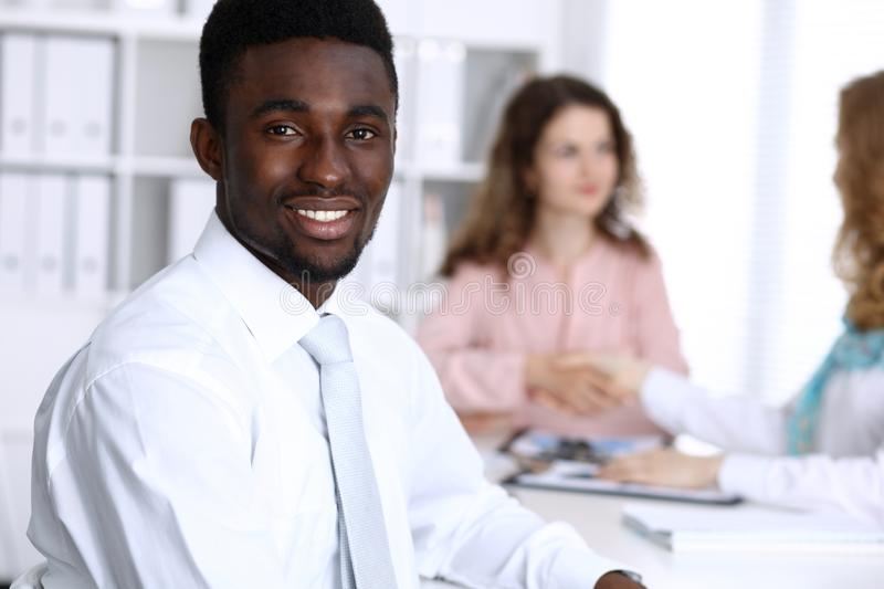African american businessman at meeting in office, colored in white. Multi ethnic business people group royalty free stock photo