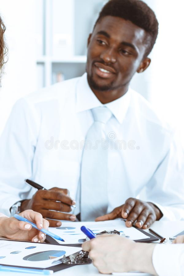African american businessman at meeting in office, colored in white. Multi ethnic business people group royalty free stock photos