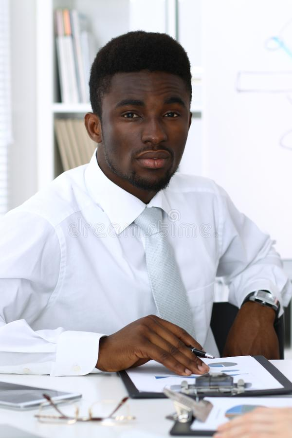 African american businessman at meeting in office, colored in white. Multi ethnic business people group stock photos