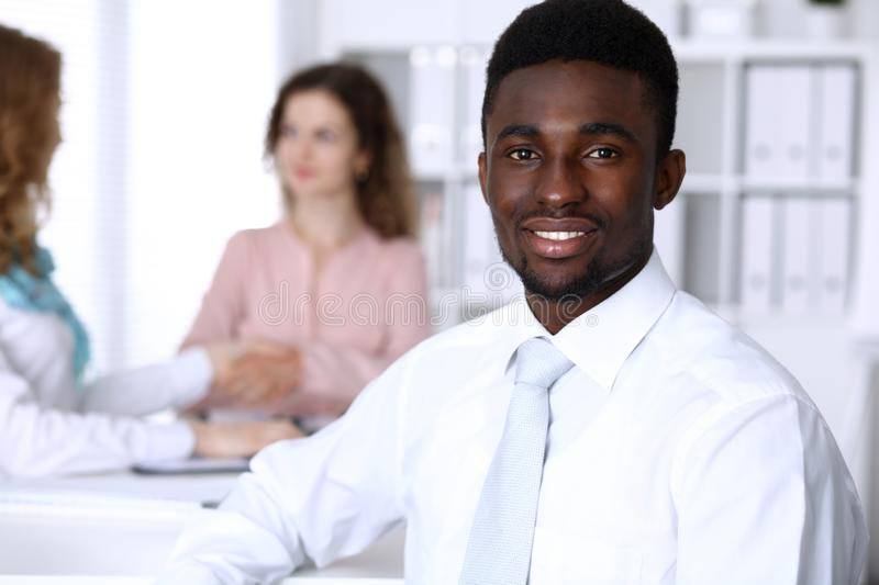 African american businessman at meeting in office, colored in white. Multi ethnic business people group stock image