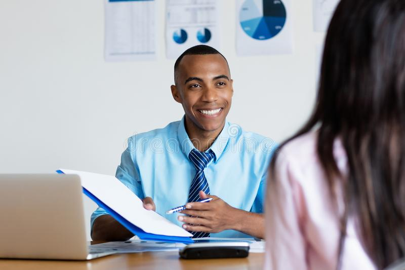 African american businessman presenting contact for new job royalty free stock photos