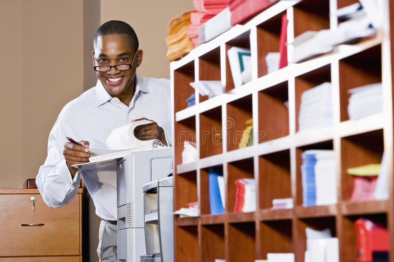 African American businessman reading document stock photos