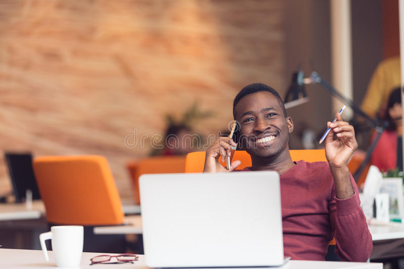 African American businessman sitting at the computer in startup office royalty free stock photography
