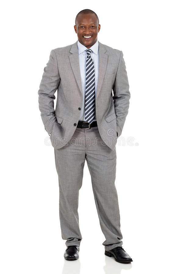 African american businessman standing. Happy african american businessman standing on white background stock images