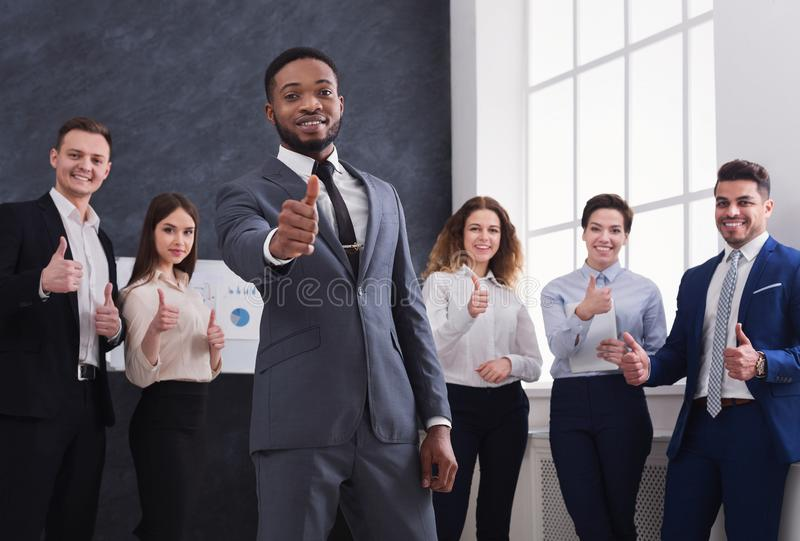 African-american businessman showing thumb up in office royalty free stock images