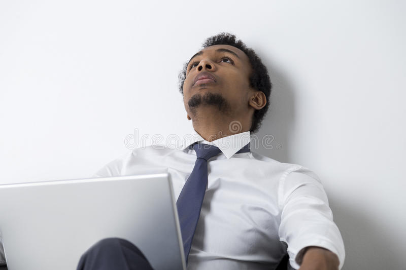 Download African American Businessman Thinking In Armchair Stock Image - Image: 83722177