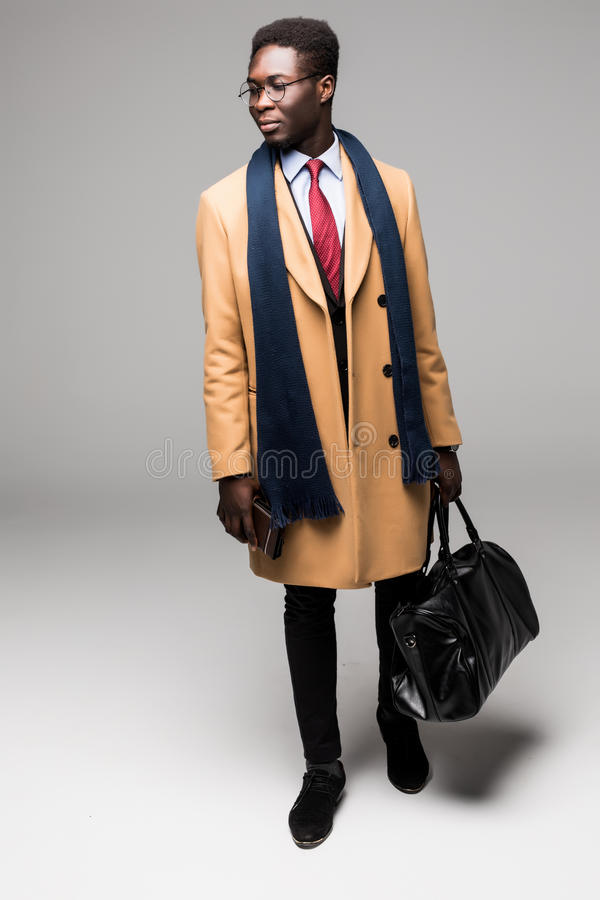 African american businessman travel with bag in coat isolated. African american businessman travel with bag isolated royalty free stock photos