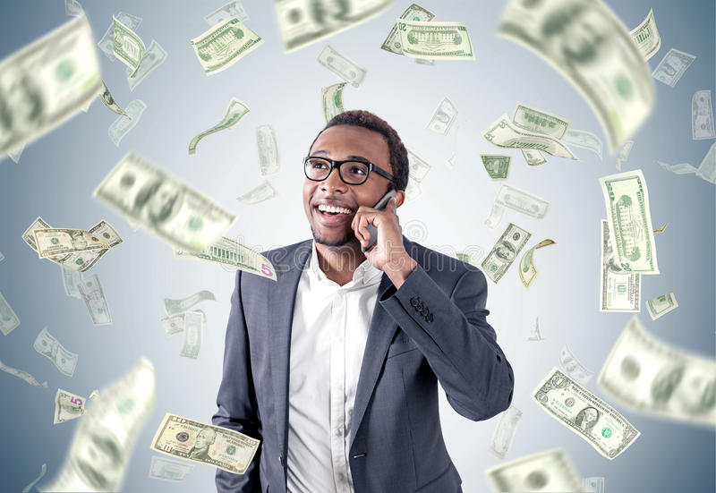 African American businessman under dollar rain royalty free stock image
