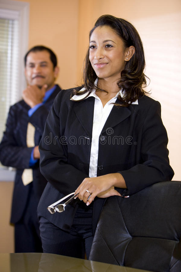 African-American businesswoman with male co-worker stock photos