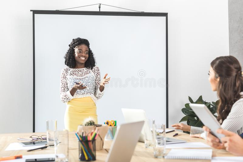 african american businesswoman presenting new business concept to royalty free stock images