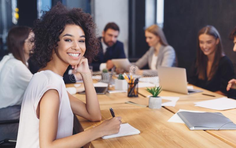 African-american businesswoman smiling at camera at meeting stock images