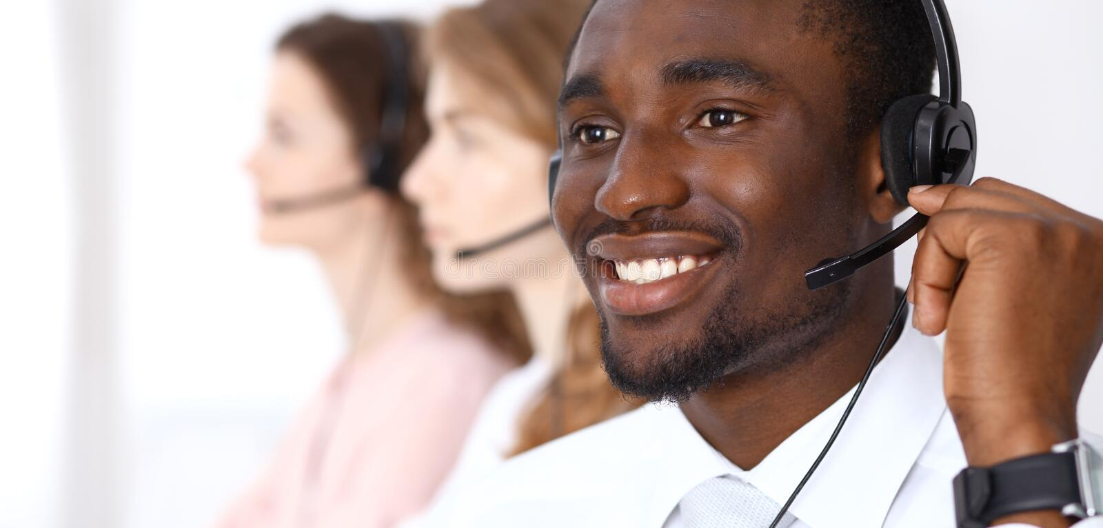 African american call operator in headset. Call center business or customer service concept stock photo