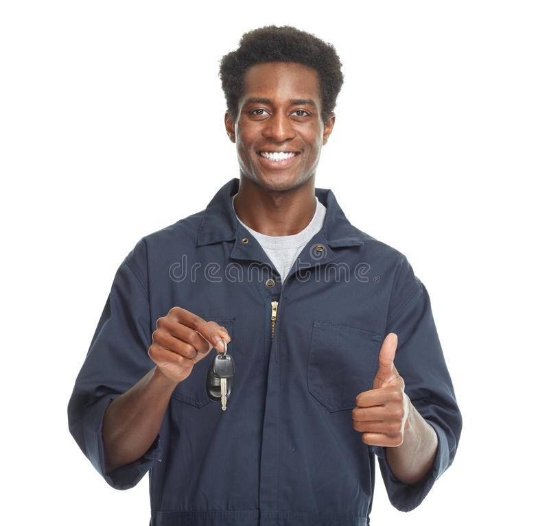African-American car mechanic. Young African-American car mechanic with key isolated white background royalty free stock photos