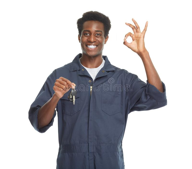 African-American car mechanic. Young African-American car mechanic with key isolated white background stock images