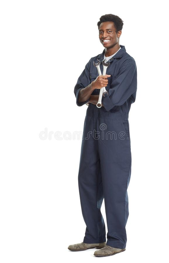 African-American car mechanic. Young African-American car mechanic with wrench isolated white background royalty free stock images