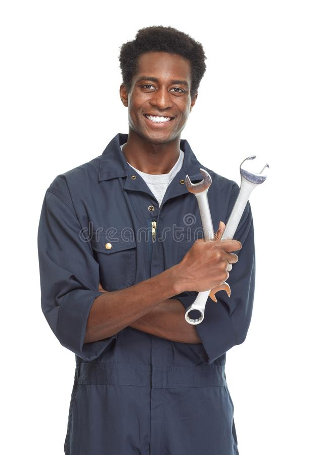 African-American car mechanic. Young African-American car mechanic with wrench isolated white background stock image