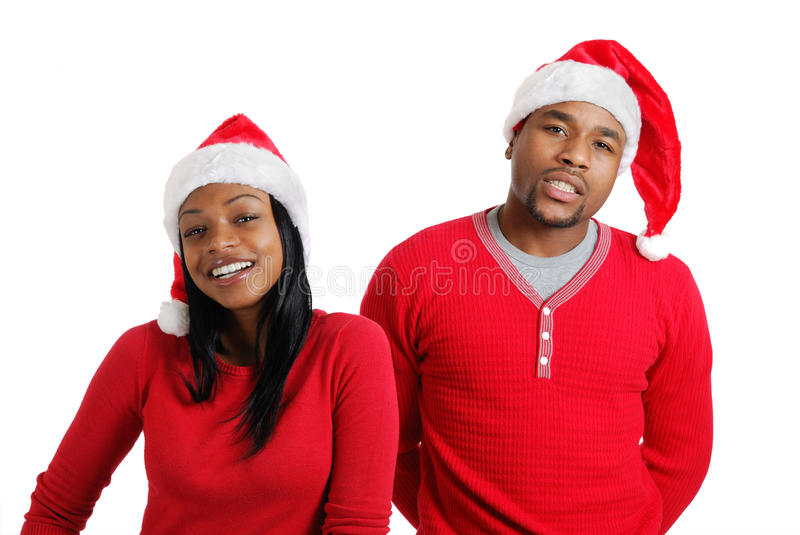 African american christmas couple with santa hats stock photography