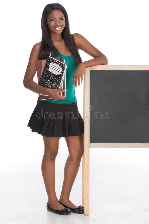 African American College student by blackboard royalty free stock image