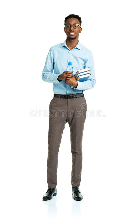 African american college student with books in his hands standing on white stock photo