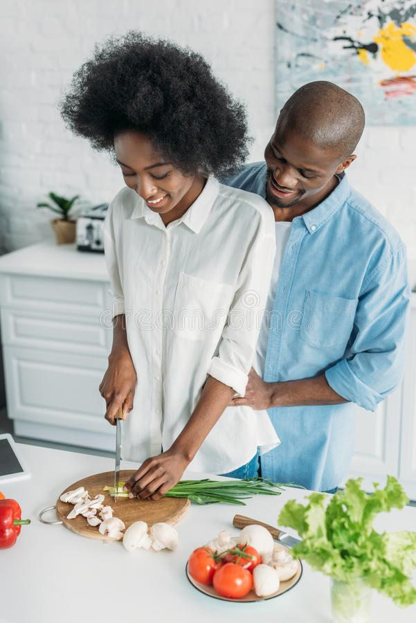 African american cooking breakfast together in kitchen. At home royalty free stock photography