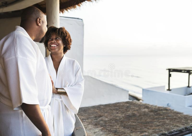 African American couple in bathrobes at hotel royalty free stock image