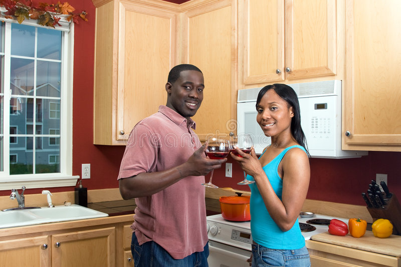 African American Couple Clinking Wine Glasses-Hor stock image