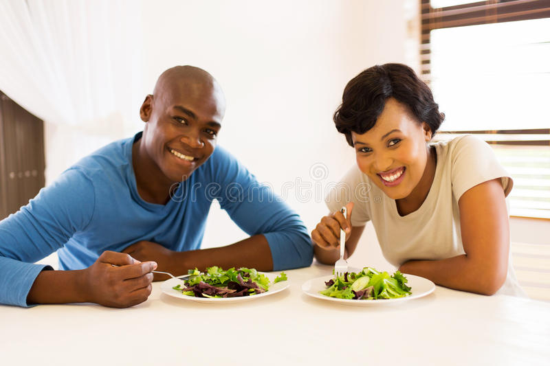 african american couple eating stock photo