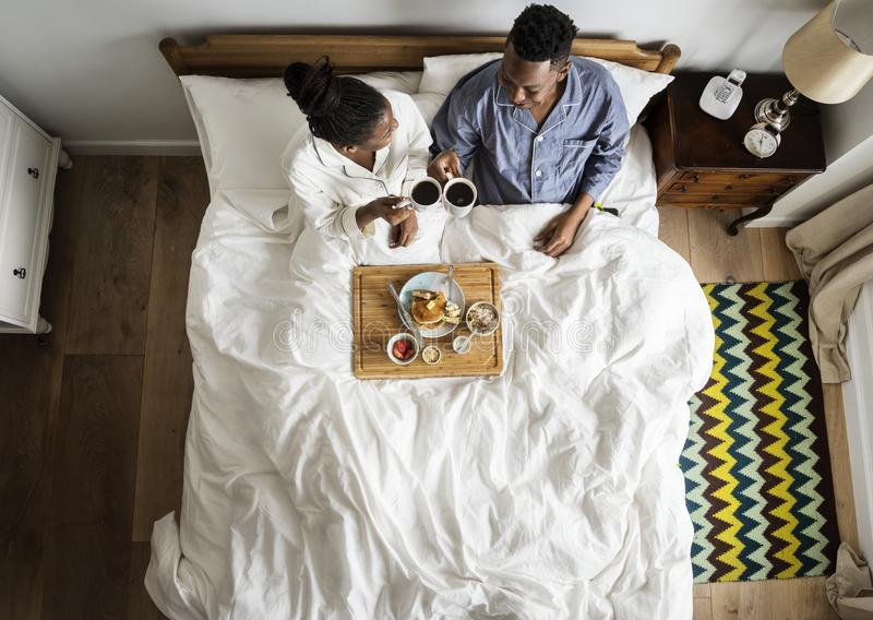 African American couple having breakfast in bed royalty free stock photography