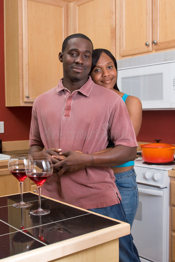 Download African American Couple Hugging In The Kitchen Stock Images - Image: 5355724