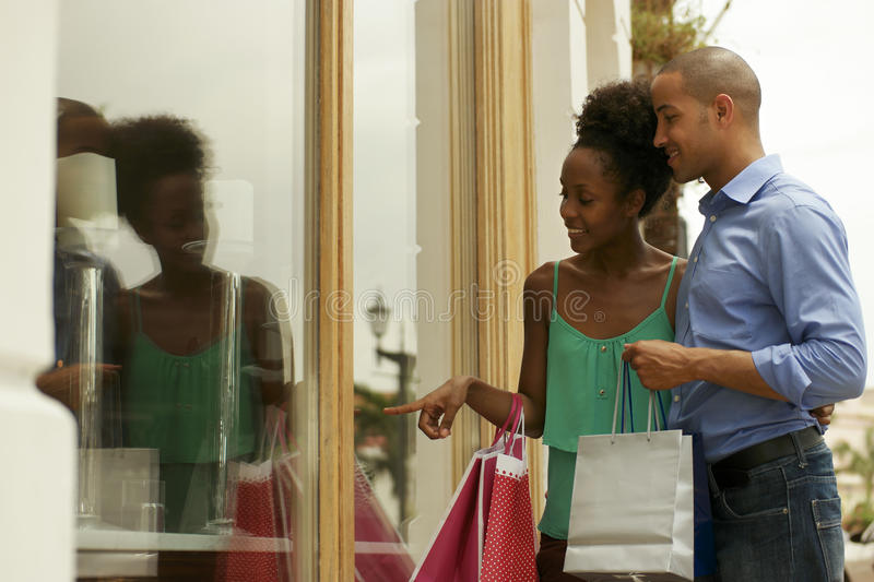 African American Couple Looking Shop Window In Panama City stock photos