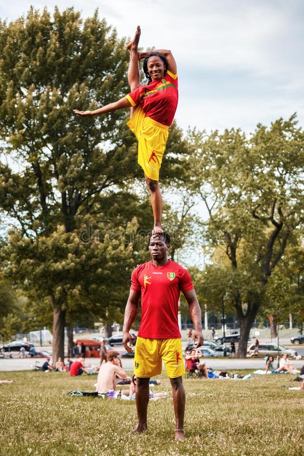 African American couple performing acrobatics show in front of the audiance in Mount Royal Park stock images