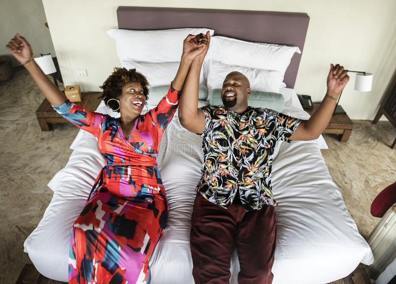 African American couple relaxing on a bed stock images
