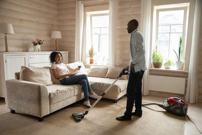 African American couple reverse roles in daily life stock images